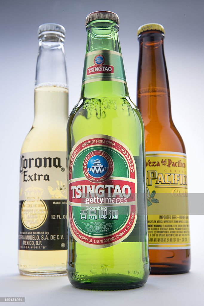 Constellation Brands Inc. Corona Extra, Tsingtao and Pacifico beers are arranged for a photograph in New York, U.S., on Tuesday, Jan. 8, 2013. Constellation Brands Inc (STZ US) was rated new 'Buy' at ISI Group by equity analyst Robert Ottenstein. The 12-month target price is $43.00 per share. Photographer: Scott Eells/Bloomberg via Getty Images