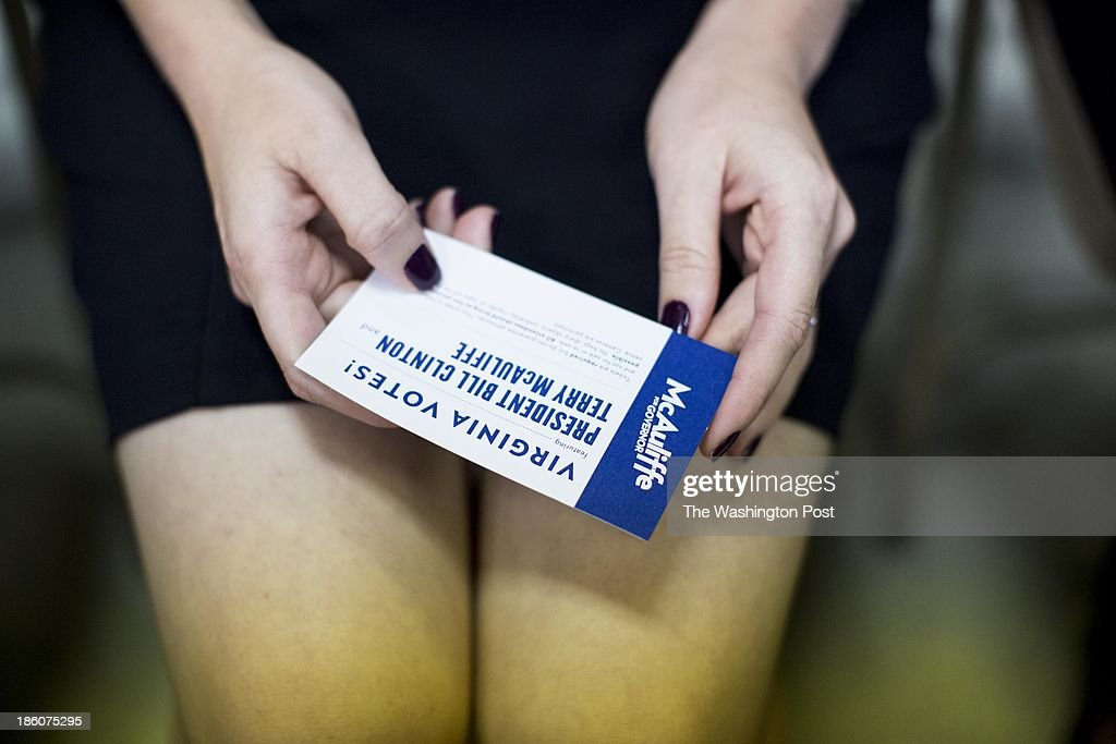 A constituent holds her ticket to a Virginia gubernatorial candidate Terry McAuliffe event with President Bill Clinton in Dale City, Virginia on Sunday October 27, 2013.