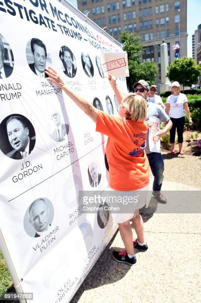 Constituents Demand That Sen McConnell 'Connect The Dots' Between Trump And Russia during a rally and march on June 3 2017 in Louisville Kentucky