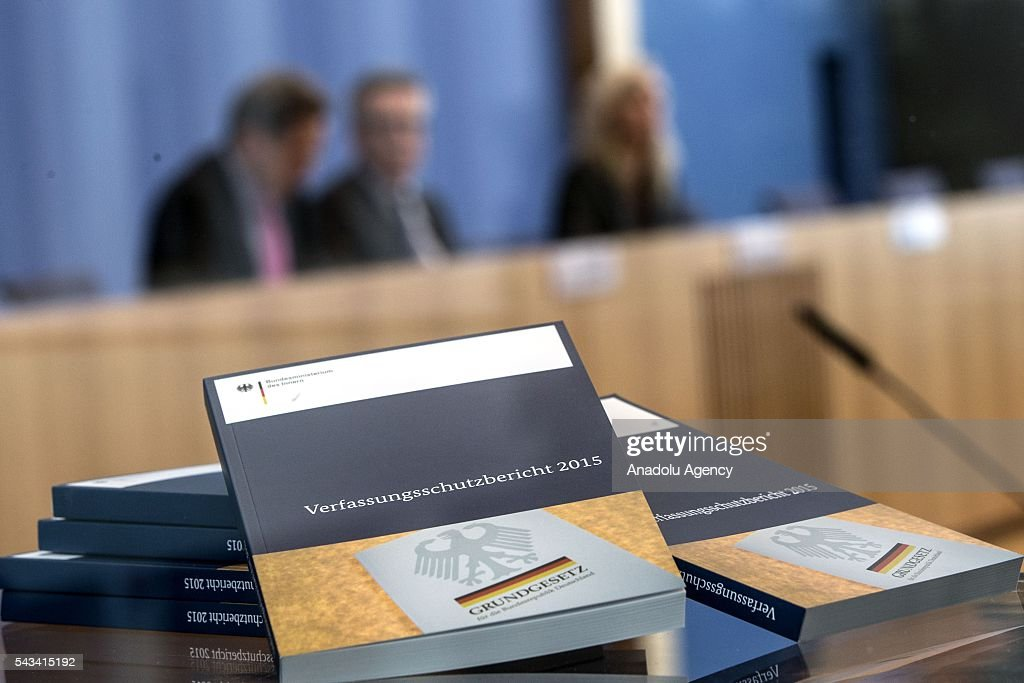 Constitution Protection Agency's 2015 reports are seen as Federal Minister of the Interior of Germany, Thomas de Maiziere and President of the Constitution Protection Agency, Hans-Georg Maassen present the Constitution Protection Agency's 2015 report, at Federal Press Center, in Berlin, Germany on June 28, 2016.