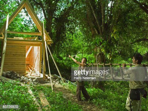 Constructing eco friendly house in the forest : Stock Photo