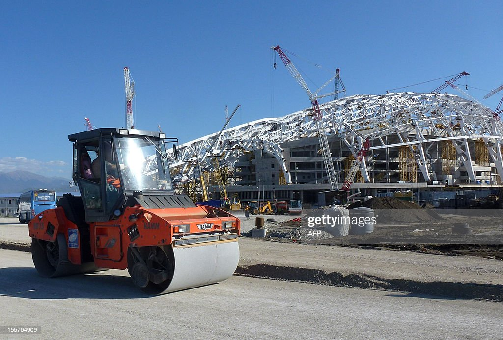 Construction at work on the Fisht olympic stadium, which will host the opening and closing ceremonies at the upcoming 2014 winter olympics in Sochi on November 6, 2012. SLIM