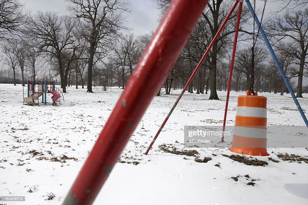 A construction barrel hangs from a swing at a park February 24, 2013 in Detroit, Michigan. The city of Detroit has faced serious economic challenges in the past decade, with a shrinking population and tax base while trying to maintain essential services. A financial review team issued a finding on February 19 identifying the city as being under a 'financial emergency.' Michigan Gov. Rick Snyder has 30 days from the report's issuance to officially declare a financial emergency, which could result in the governor appointing an emergency financial manager to oversee Detroit's municipal government.