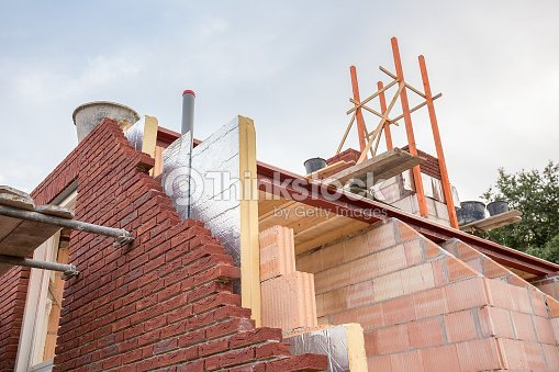 Construction building of new house with insulation : Stock Photo