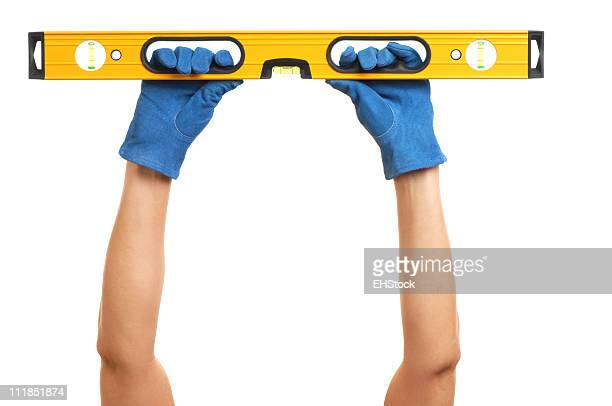 Construction Carpentry Level Held by Woman's Arms on White