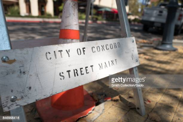 Construction cone and barrier with text reading 'City of Concord Street Maint' at a construction site in downtown Concord California September 8 2017...