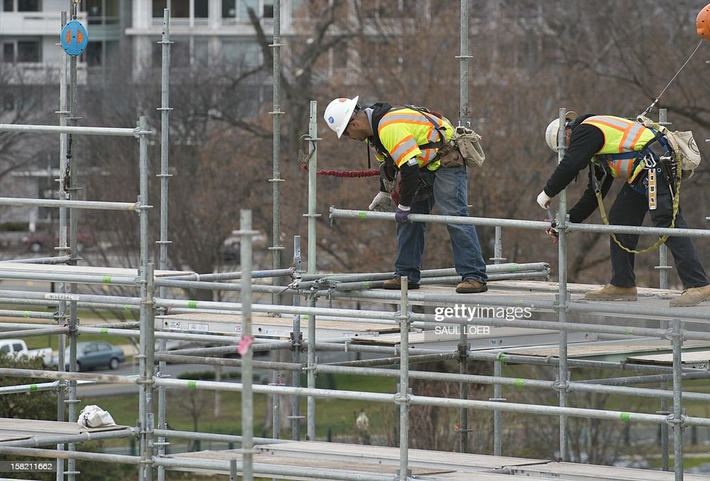 Construction continues as workers build the platform to be used for the Presidential Inauguration ceremony on the west front of the US Capitol in Washington, DC, as seen on December 11, 2012. US President Barack Obama's second inauguration will take place with a public ceremonial oath of office on January 21, 2013. AFP PHOTO / Saul LOEB
