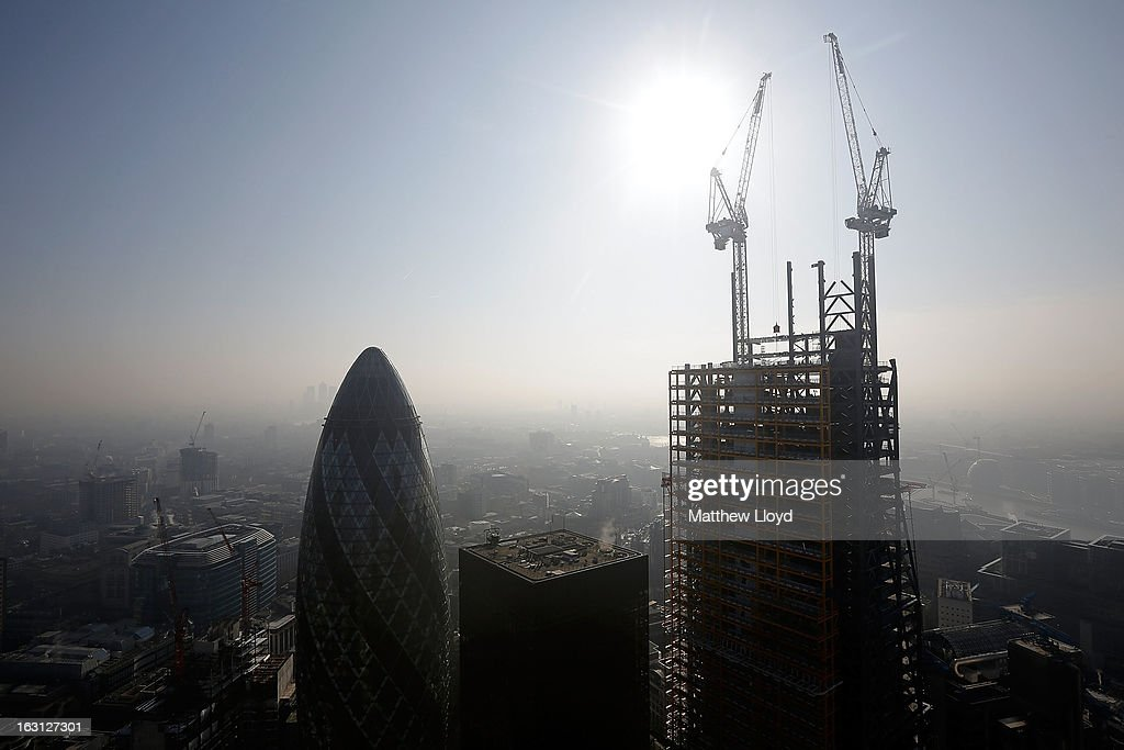 Construction continues at 122 Leadenhall Street (right), nick named the Cheesegrater, next to the Gherkin (left) on March 5, 2013 in London, England. The recent construction of numerous tall buildings on the London skyline has been controversial due to concerns that views of historic landmark buildings, such as St Paul's cathedral, are being obscured.