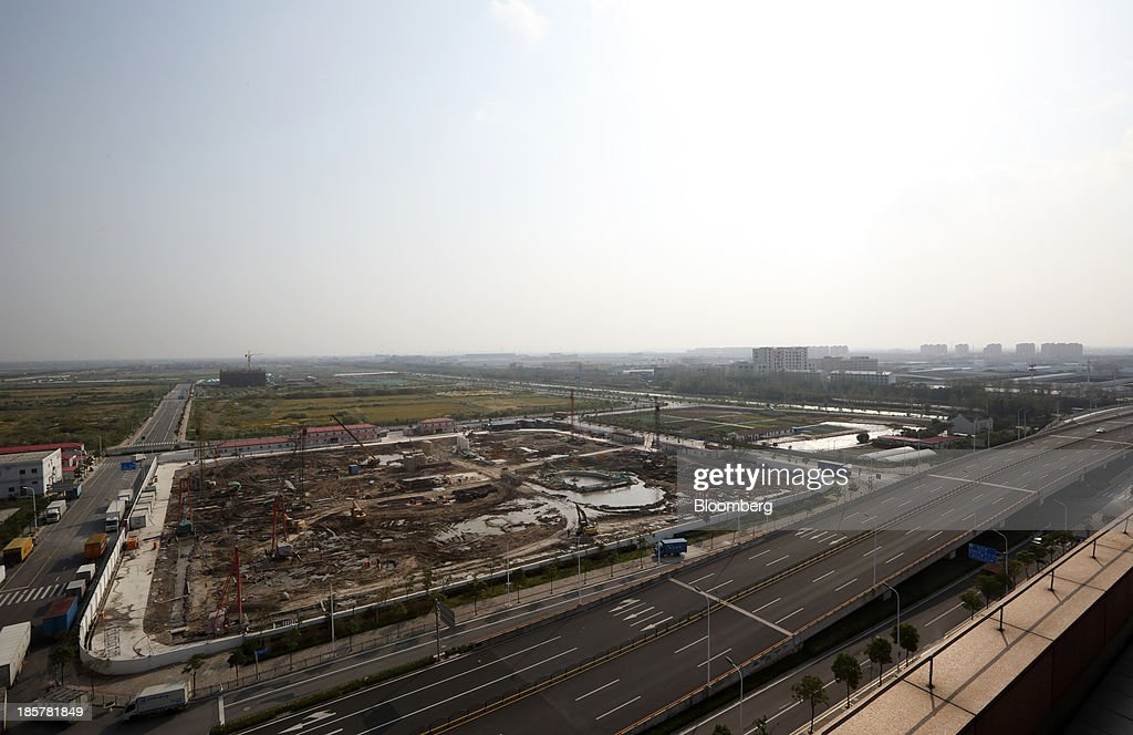 Construction continues at China (Shanghai) Pilot Free Trade Zone's Pudong free trade zone in Shanghai, China, on Thursday, Oct. 24, 2013. The area is a testing ground for free-market policies that Premier Li Keqiang has signaled he may later implement more broadly in the world's second-largest economy. Photographer: Tomohiro Ohsumi/Bloomberg via Getty Images