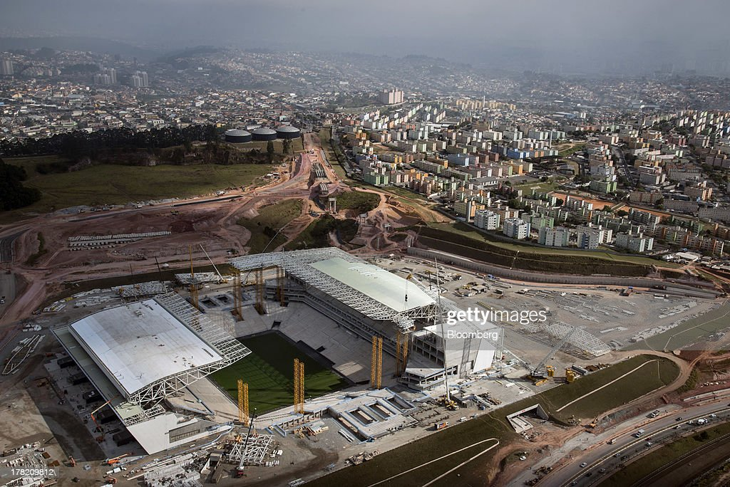 Construction continues at Itaquera Stadium in this aerial photo of eastern Sao Paulo, Brazil, on Friday, Aug. 23, 2013. Home sales in Sao Paulo, Brazils biggest real-estate market, rose 46 percent in January through June from a year earlier, while housing starts climbed 51 percent, according to Embraesp, a property research group, and Secovi, a real-estate agency association. Photographer: Paulo Fridman/Bloomberg via Getty Images