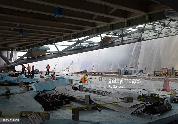 Construction continues at the new hotel and transit center at Denver International Airport February 4 2015 Crews work on the open air platform...