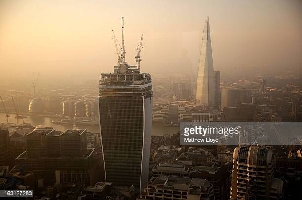 Construction continues on the 20 Fenchurch Street skyscraper which has been nicknamed the walkietalkie in front of the recently completed Shard on...