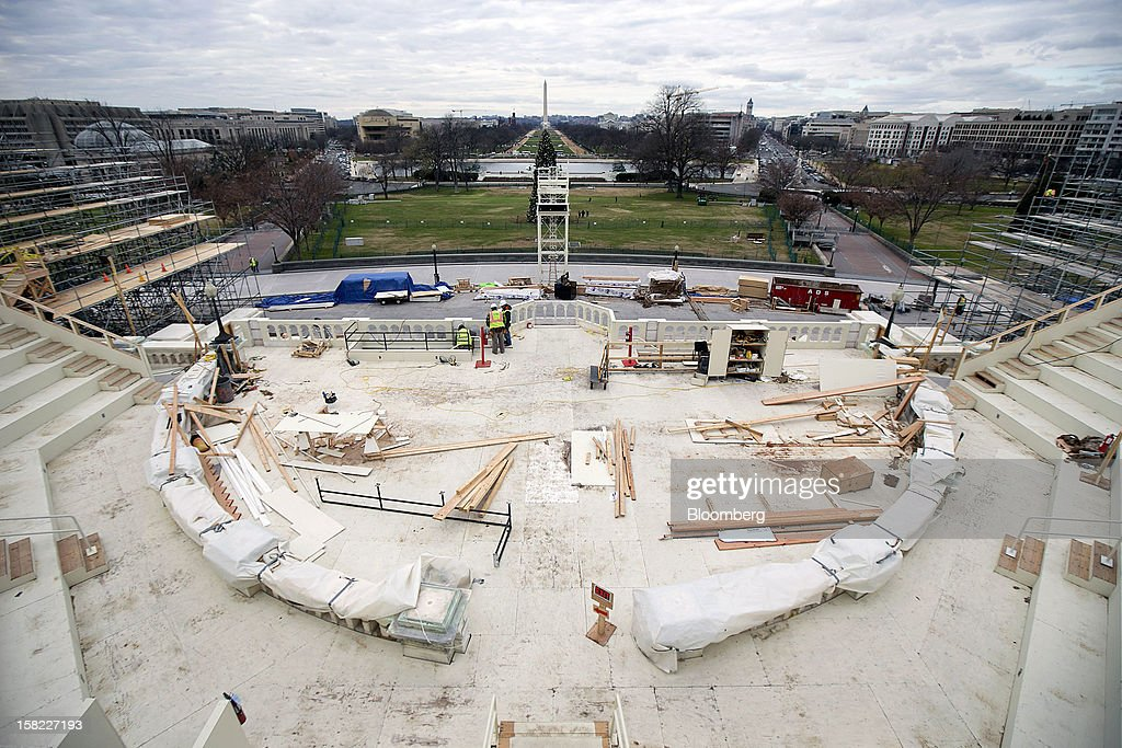 Construction continues on the platform being built on the west front of the U.S. Capitol in preparation for the inauguration ceremony of U.S. President Barack Obama in Washington, D.C., U.S., on Tuesday, Dec. 11, 2012. The presidential inauguration ceremony will take place on Jan. 21, 2013. Photographer: Andrew Harrer/Bloomberg via Getty Images