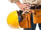 Detail close up of construction contractor carpenter close on toolbelt isolated on white background