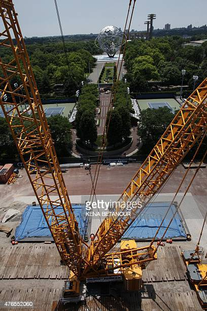 A construction crane at Arthur Ashe Stadium where the final piece of steel for the roof structure is being installed at the USTA Billie Jean King...