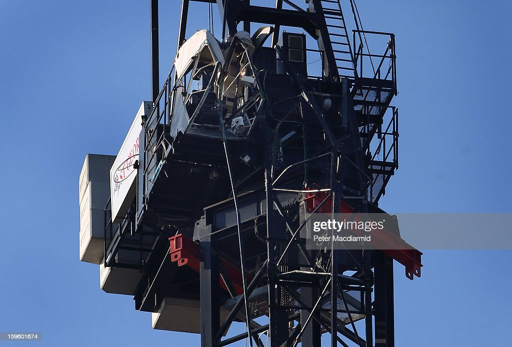 A construction crane beside the St George's Wharf building is badly damaged after a helicopter crashed into it, on January 17, 2013 in London, England. Police cordons have remained in place as investigations continue into the cause of yesterday's helicopter crash in which two people died.