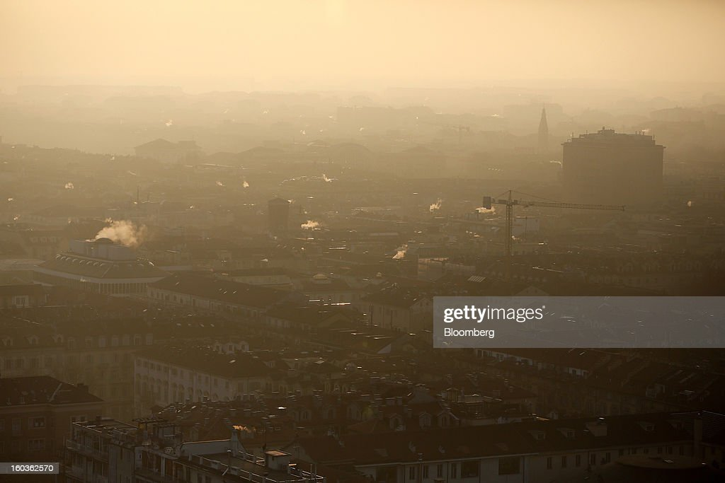 A construction crane is seen amongst buildings and properties from the top of the Mole Antonelliana in Turin, Italy, on Tuesday, Jan. 29, 2013. Italy sold 8.5 billion euros ($11.4 billion) of six-month Treasury bills as rates dropped to the lowest in almost three years as the European Central Bank's pledge to buy bonds continues to provide an effective backstop even amid rising political concerns. Photographer: Alessia Pierdomenico/Bloomberg via Getty Images