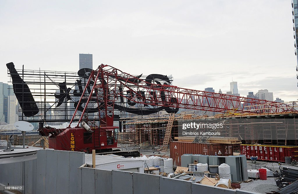 A construction crane lies mangled behind a sign after it collapsed on January 9, 2013 in the Queens borough of New York City. The crane collapse injured seven construction workers on the site in the Long Island City neighborhood.