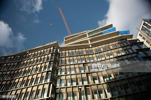 A construction crane operates above the Zig Zag office and retail building development by Land Securities Group Plc in London UK on Monday Jan 19...