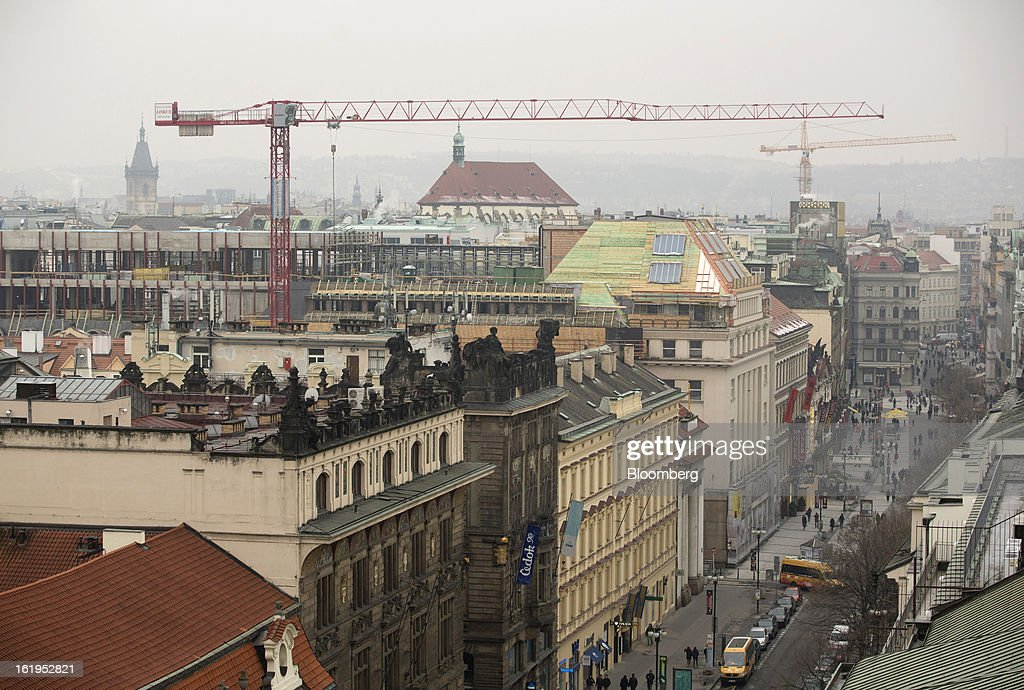 A construction crane stands above buildings in the city center against the skyline of Prague, Czech Republic, on Sunday, Feb. 17, 2013. Worsened outlook for Czech economy is in line with the government's expectations and lower-than-planned tax revenue is 'manageable' under 2013 budget, Prime Minister Petr Necas said on Czech public television. Photographer: Martin Divisek/Bloomberg via Getty Images