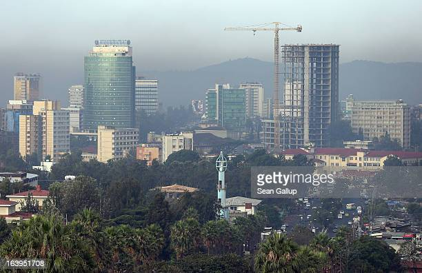 A construction crane stands among office buildings over the city center on March 18 2013 in Addis Ababa Ethiopia Ethiopia with an estimated 91...