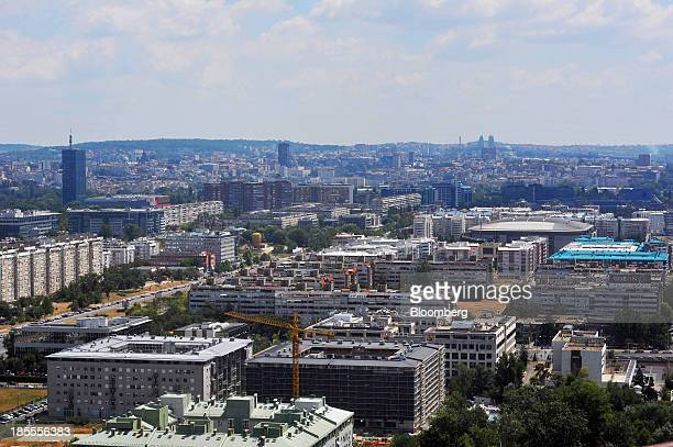 A construction crane stands as the city skyline stretches out beyond Belgrade Serbia on Monday Oct 21 2013 Serbia's government revealed a salvo of...