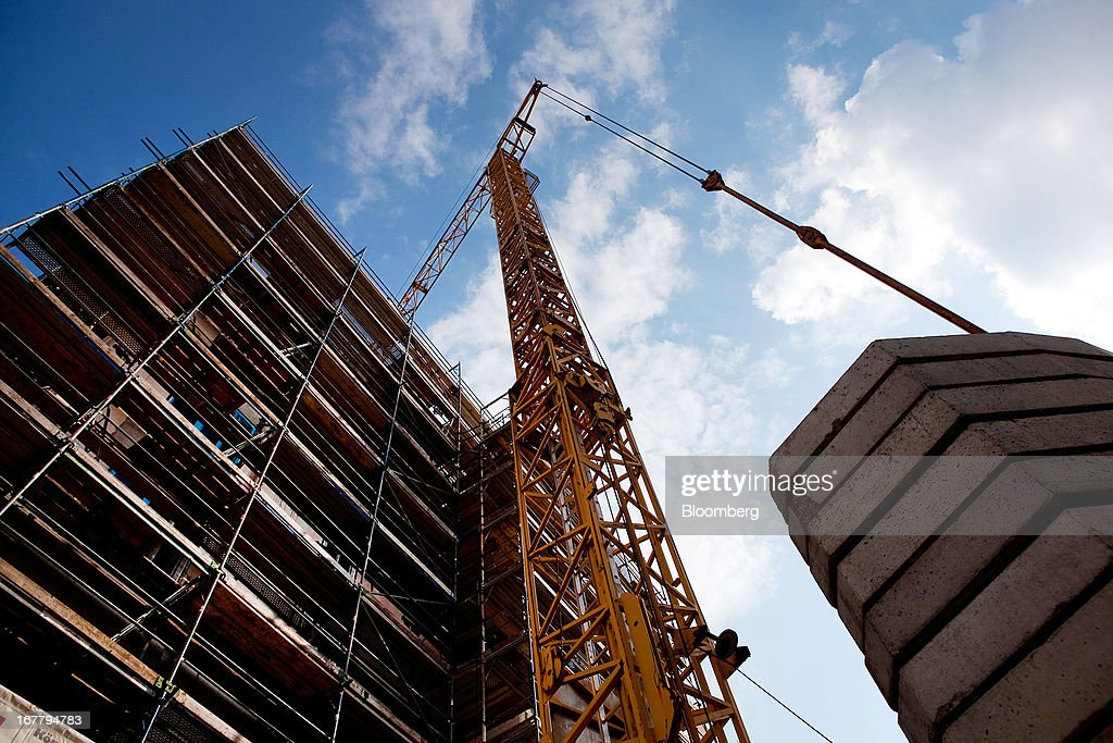 A construction crane stands over a block of residential housing on a building site located in the Mitte district of Berlin, Germany, on Monday, April 29, 2013. Rents and home prices in Germany's largest cities are rising at the fastest rate in twenty years, according to data compiled by Bulwien Gesa AG. Photographer: Krisztian Bocsi/Bloomberg via Getty Images