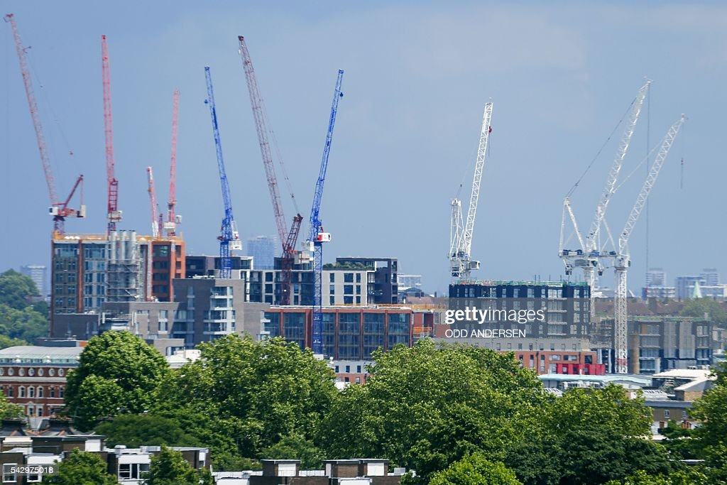 Construction cranes are pictured over a building complex under development, from Primrose Hill in north London on June 25, 2016, after the announcement that the UK had voted on June 23 to leave the European Union in a national referendum. The result of Britain's June 23 referendum vote to leave the European Union (EU) has pitted parents against children, cities against rural areas, north against south and university graduates against those with fewer qualifications. London, Scotland and Northern Ireland voted to remain in the EU but Wales and large swathes of England, particularly former industrial hubs in the north with many disaffected workers, backed a Brexit. / AFP / Odd ANDERSEN
