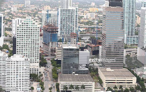 Construction cranes are seen June 3 2014 in Miami Florida According to numerous scientists south Florida could be flooded by the end of the century...
