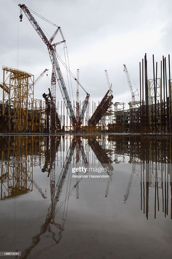 Construction cranes for the Olympic stadium 'Fisht' are reflected in a puddle on February 10, 2012 in Sochi, Russia. The 'Fisht' will host the opening and the closing ceremonies of the 2014 Olympic and Paralympic Winter Games in the Black Sea resort of Sochi. The stadium with a capacity of 40,000 spectators is expected to be completed in May 2013 and will host football matches including the 2018 FIFA World Cup following the Games.