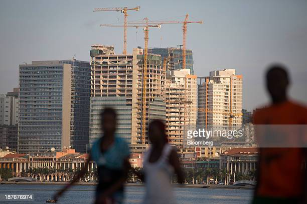 Construction cranes operate among new skyscrapers being built in the business district of Luanda Angola on Saturday Nov 9 2013 Angola the largest...
