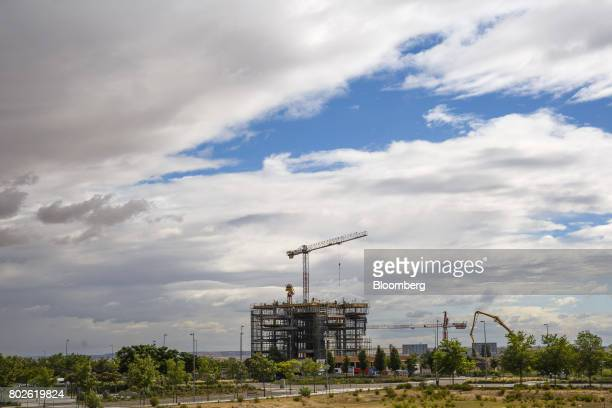 Construction cranes operate at a development site for new residential tower blocks in Madrid on Wednesday June 28 2017 Bankia SA agreed to...