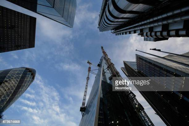 Construction cranes operate on the Scalpel commercial skyscraper as it stands among other high rise buildings in the City of London UK on Monday Nov...