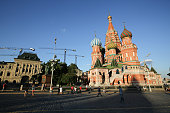 Construction cranes stand above buildings beyond St Basil's cathedral right on Red Square in Moscow Russia on Monday June 8 2015 Rents in Moscow's...