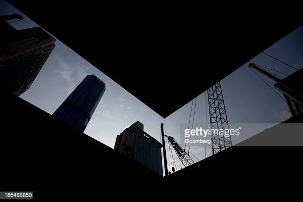 Construction cranes stand in the North Point area of Hong Kong China on Friday Oct 18 2013 Hong Kong's September consumer prices rose 46% from a year...