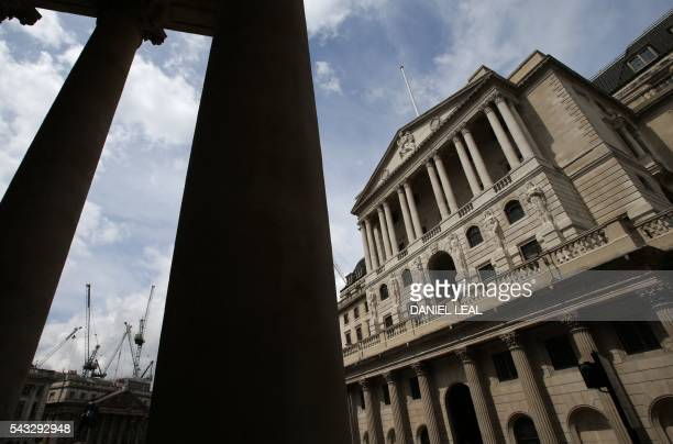 Construction cranes stand on the horizon beyond the Bank of England in the City of London on June 27 2016 Britain should only trigger Article 50 to...