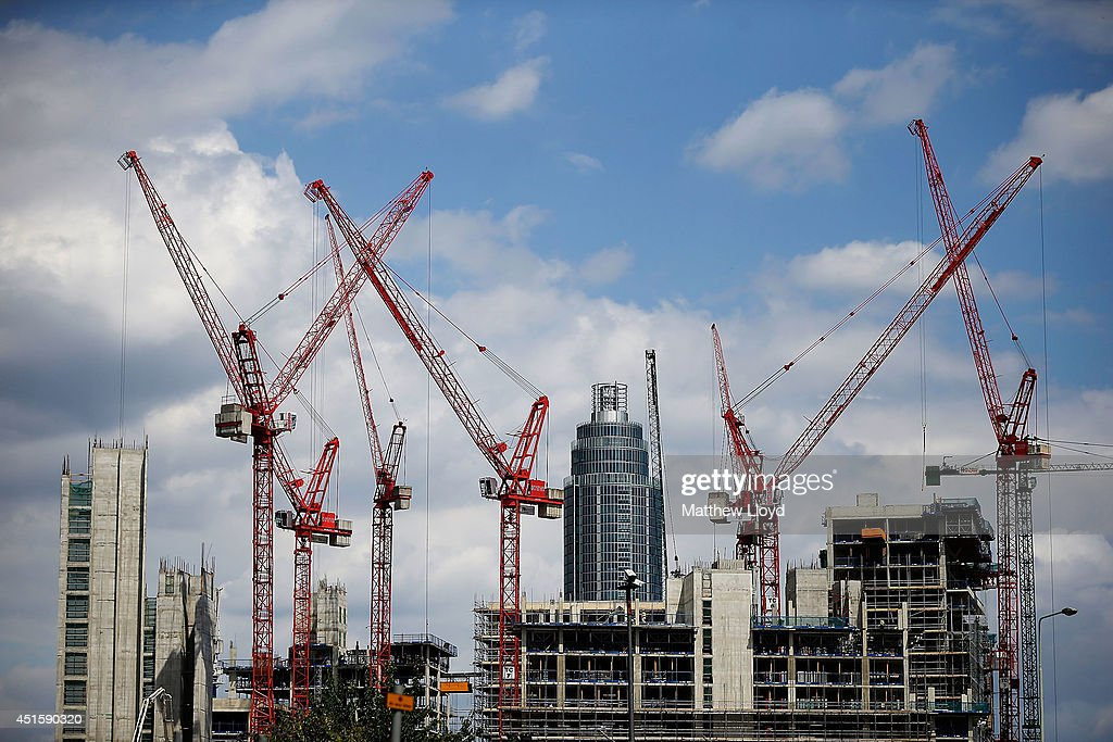 Construction cranes working on the Embassy Gardens luxury development in Battersea, with the St George Wharf tower in the background on July 1, 2014 in London, England. Hundreds of high rise office and residential towers are either under construction or submitted for planning permission, with concerns being raised by some that the skyline of London will be changed drastically.