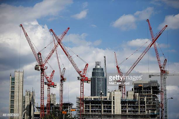 Construction cranes working on the Embassy Gardens luxury development in Battersea with the St George Wharf tower in the background on July 1 2014 in...