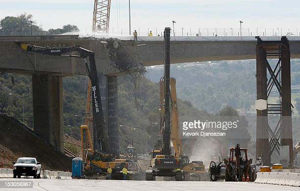 Construction crews continue to demolish a portion of the Mulholland Drive bridge above the 405 Freeway on September 29 2012 in Los Angeles California...