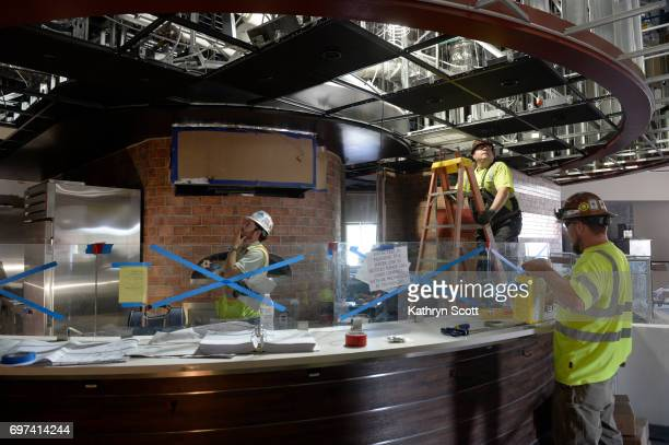 Construction crews continue work next to the pizza oven inside the cafeteria on the Anschutz Student Center on the Colorado Christian University...