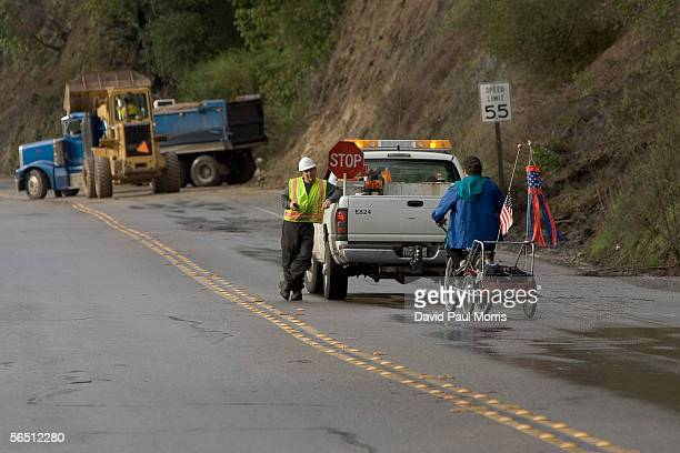 Construction crews work on a mudslide on River Road on January 2 2006 in Guerneville California Northern California has been inundated by heavy rain...