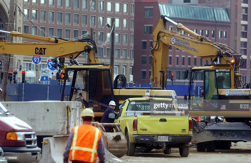 Construction crews work on site at the 'Big Dig' November 19, 2004 in Boston, Massachusetts. More than 400 leaks have been discovered recently, due to faulty watereproof panels along the Interstate 93 section of the nation's costliest federally funded transportation project. Already at 14.6 billion dollars, Big Dig officials expect the leaks to cost upwards of 10 million more, and years to fix.