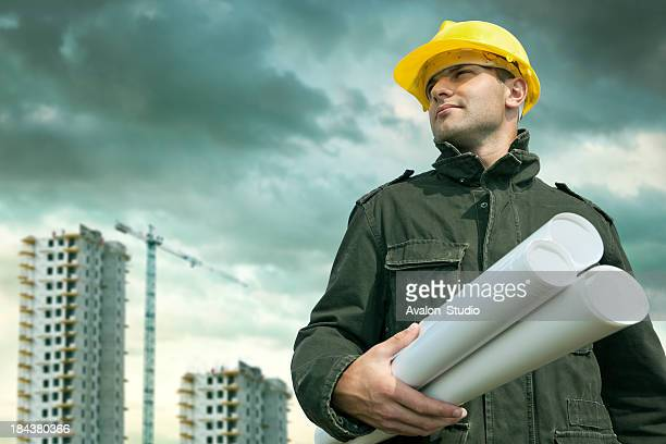 Construction engineer at a construction site with the plans.