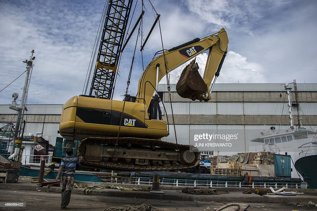 A construction equipment is loaded on a ship in the port of Surabaya eastern Java island destined for South Kalimantan in Indonesia's Borneo island...