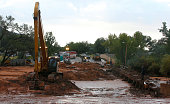 Construction equipment removes flood debris from Short Creek as it crosses Central Street on September 15 2015 in Colorado City Arizona Flash floods...