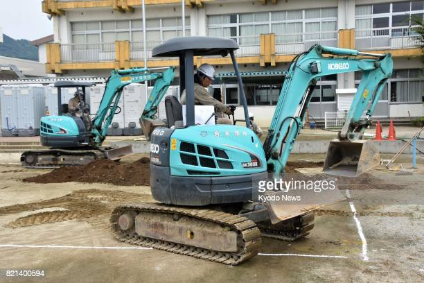 Construction for a temporary elementary school building gets underway on July 24 in Asakura Fukuoka Prefecture which was severely hit by torrential...