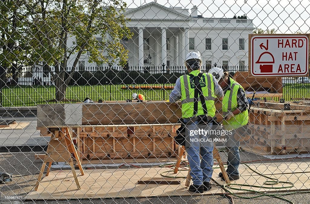 Construction for US President Barack Obama's second inauguration is under way in front of the White House in Washington on November 10, 2012. Obama has won Florida's 29 electoral votes in the presidential election, further fattening his substantial margin of victory in what had been predicted to be a close race. The state was the last to report its tally from the election last Tuesday, in which Obama beat Republican Mitt Romney. With Florida's votes in the electoral college, the president's total goes up to 332, against 206 for Romney. AFP PHOTO/Nicholas KAMM