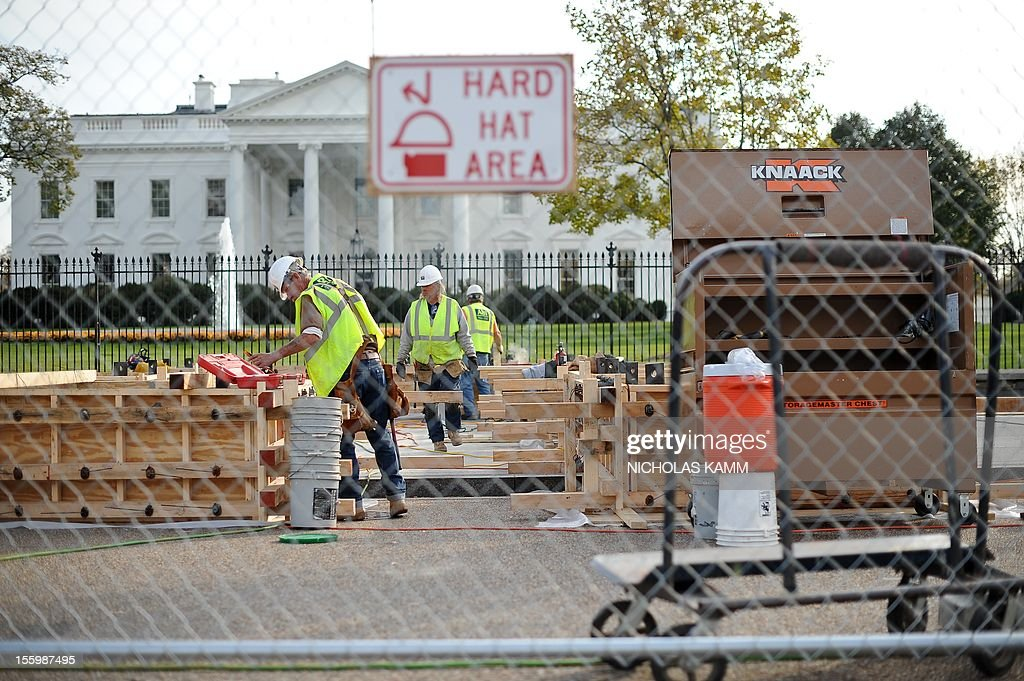 Construction for US President Barack Obama's second inauguration is under way in front of the White House in Washington on November 10, 2012. Obama won Florida's 29 electoral votes in the presidential election on November 10, further fattening his substantial margin of victory in what had been predicted to be a close race. The state was the last to report its tally from the election November 6, in which Obama beat Republican Mitt Romney. With Florida's votes in the electoral college, the president's total goes up to 332, against 206 for Romney. AFP PHOTO/Nicholas KAMM