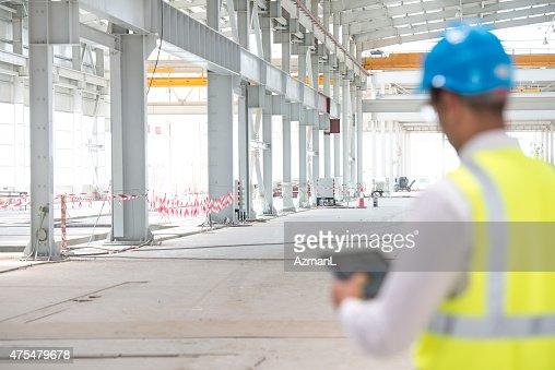 Construction Foreman Checking Progress