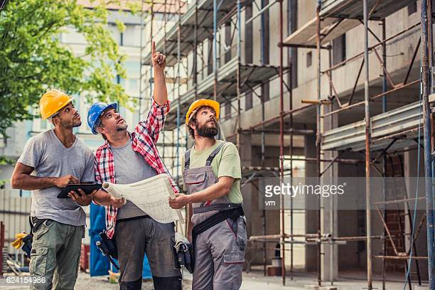 Construction foreman instructing the workers